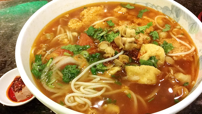 Bun Rieu OC - Crab tomato noodle soup with minced meat with periwinkle